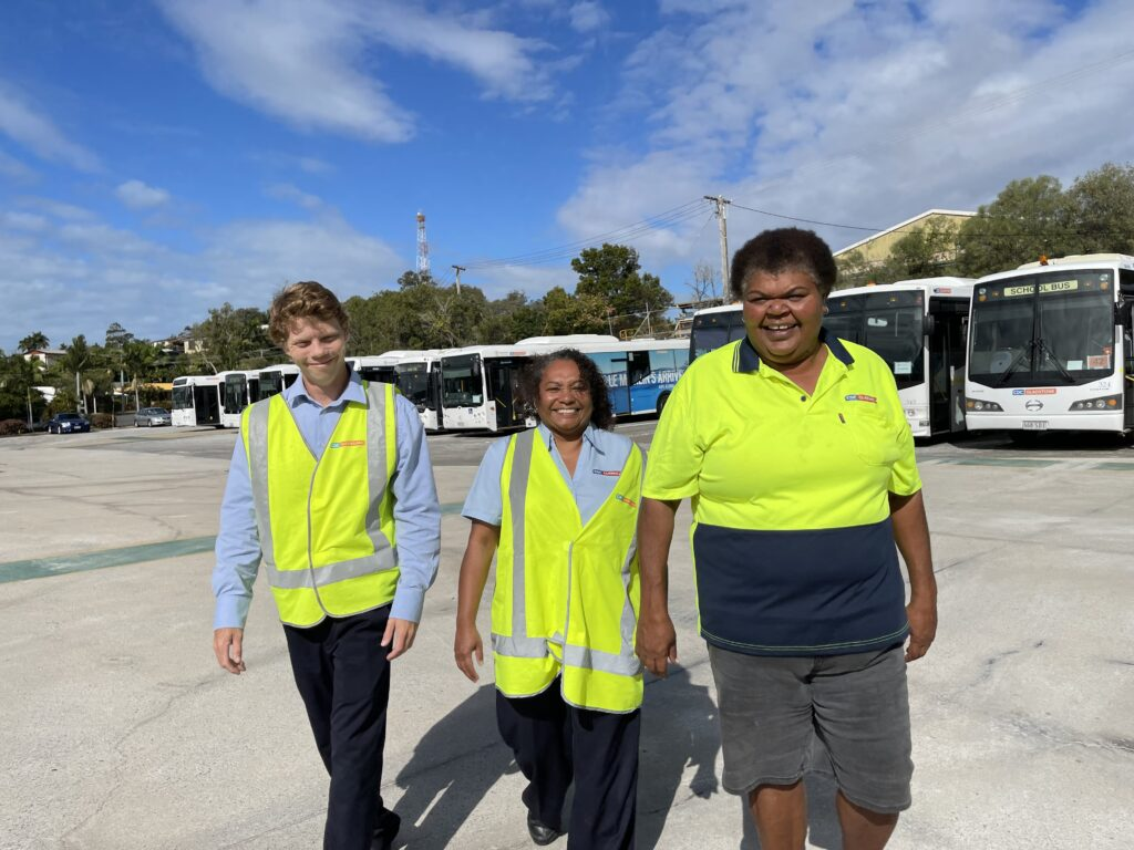Roz Smiling In Front Of Buses