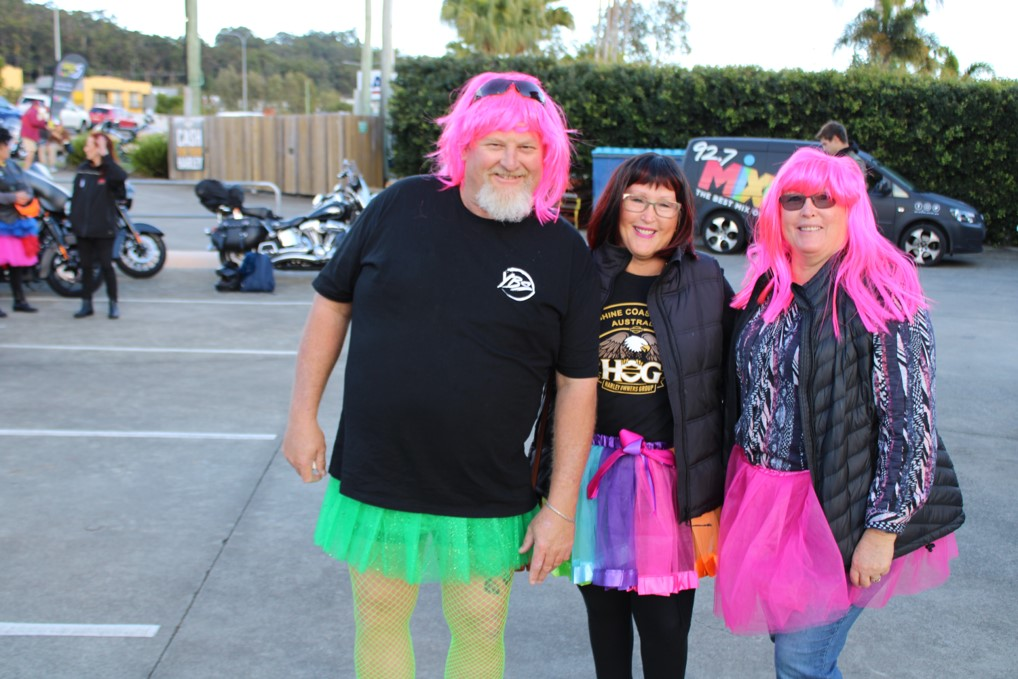 Steve Smiling With People Wearing Pink Wig